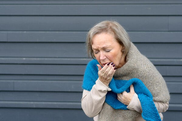bigstock-Elegant-Senior-Woman-Coughing--159934796