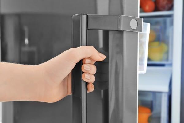 bigstock-Woman-opening-refrigerator-doo-219262309